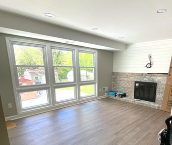 After- Lighting, whitewash brick, accent wall, updated fireplace & flooring
