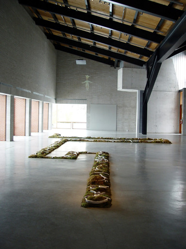 "Christian Bernard Singer Chaconne de Paeton, 2005 Moss, earth, unfired clay, engobe, video projection 70' x 45' x 8"" Canadian Clay and Glass Gallery, Waterloo"