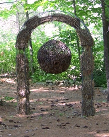 "Christian Bernard Singer Nest Hotel (after), 2008 Straw, hay, cane, pine needles, seeds and metal 8.5' x 40"" x 16"" Kiwi Garden Sculpture Project"