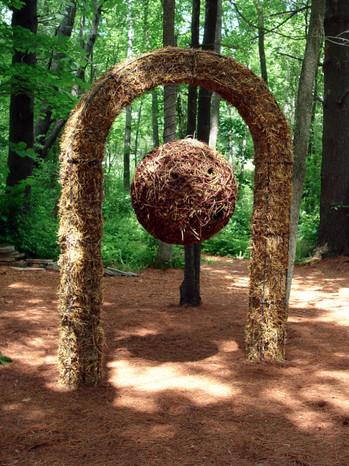 "Christian Bernard Singer Nest Hotel, 2008 Straw, hay, cane, pine needles, seeds and metal 8.5' x 40"" x 16"" Kiwi Garden Sculpture Project"