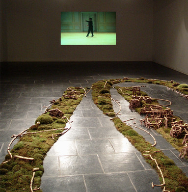 Christian Bernard Singer in collaboration with Linda Sormin Sarabande, 2002 Mosses, earth, unfired earthenware, gold leaf and video projection Robert Turner Gallery, New York State College of Ceramics at Alfred University, Alfred, NY
