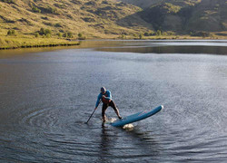 paddle boarder on water