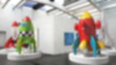3d model of exhibition with cartoon rockets on pedestals and diagrams on white walls