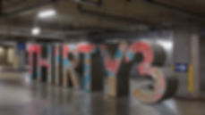 thirty three text 3D model cement structure with distressed pealing pint in red gray and red in underground parking lot