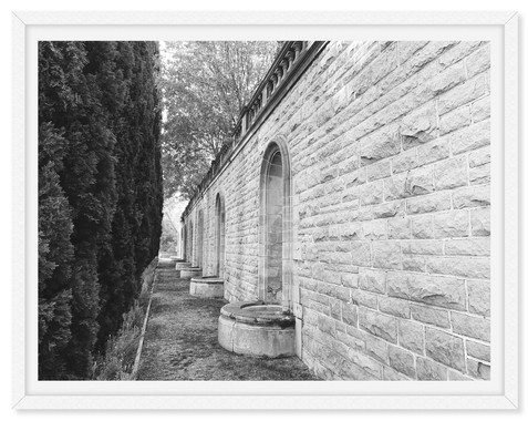 brick wall trees fountain black and whit