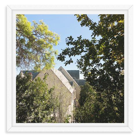 slanted roof blue sky trees garden wall