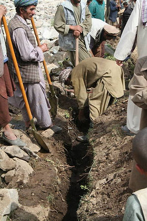 Mountain area: Village men bury our drinking water tubes against freezing in winter.