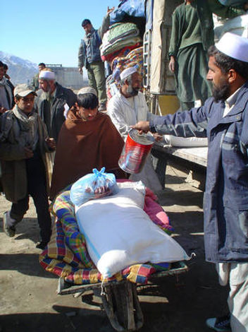 Handing out food items to the needy