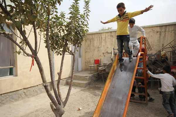 Boys on slide Kabul