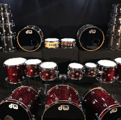A battery of DW Collectors Series Drums!