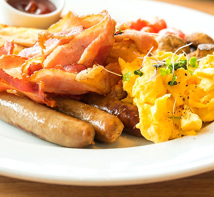Fox Bros. Breakfast Links on a plate with eggs and bacon