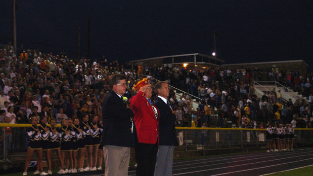 """Mr. Hershel """"Woody"""" Williams is joined by Mr. Clyde Dodd and Mr. Thomas Dragich during pre-game, where Mr. Williams and Mr. Dodd were recognized for their contributions to East Fairmont High School"""