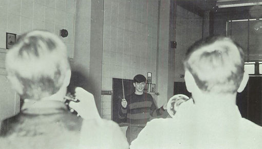 John Heck and Larry Davis practice, band commander John Onderko serves as director in the absence of the teacher