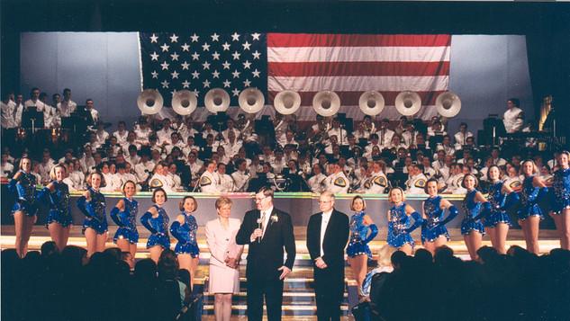 Gary Steele, Booster President, makes a speech following Showcase 2002