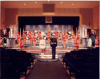Representatives of the Marines, Army, Navy, Air Force and Coast Guard join the Busy Bee Band & Honeybees for the closing of Follies '97.