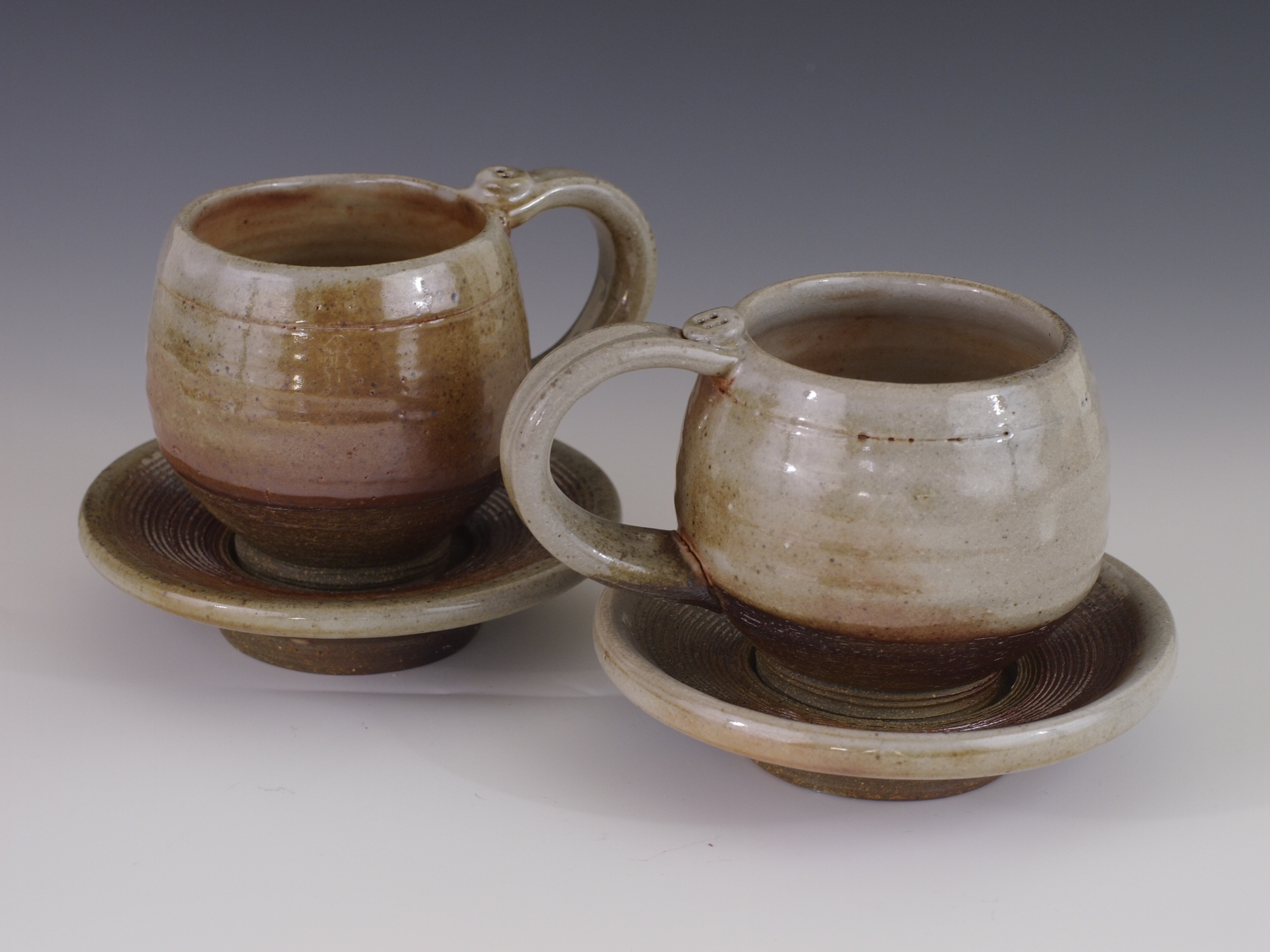 Shino teacups with saucers