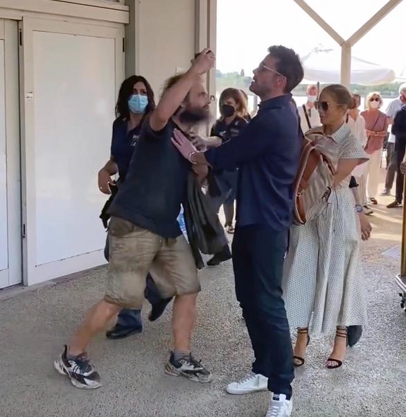 Ben Affleck protects Jennifer Lopez from  overzealous fan trying to snag selfie in Venice, Italy