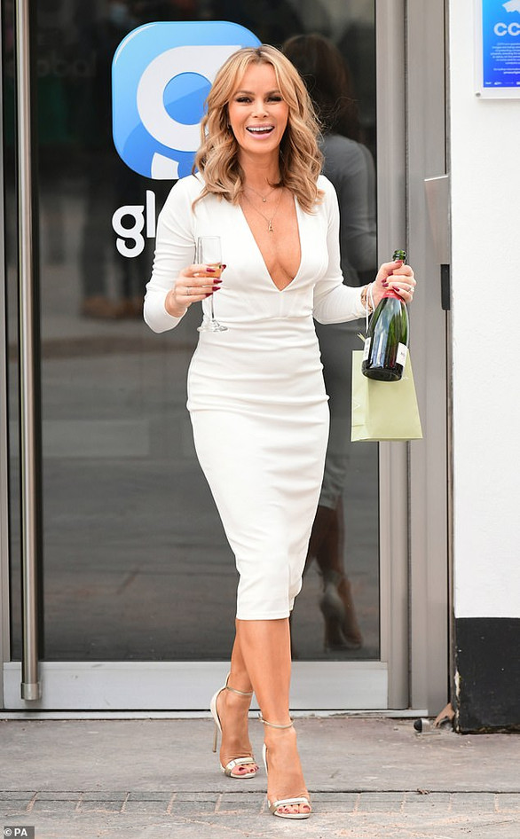 Amanda Holden braves the cold in a plunging dress on her 50th birthday at the Heart Radio studios