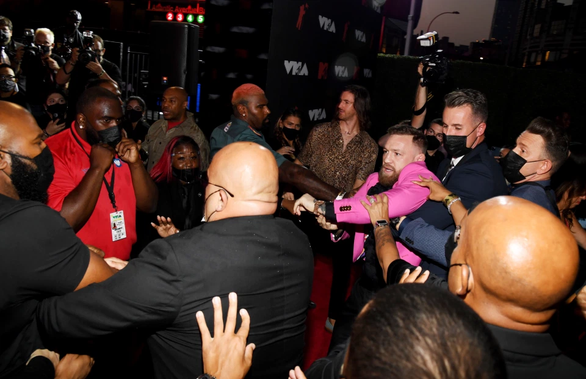 UFC star Conor McGregor and machine gun Kelly almost come to blows on MTV VMAs red carpet