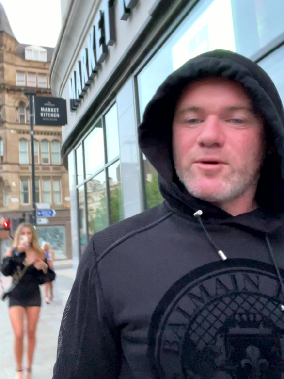 Wayne Rooney filmed with two blondes as he walked back to budget hotel with the young women