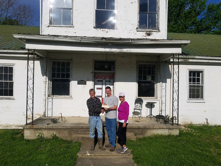 The Beehive Augusta Tavern Gives Donation to Echo Hall