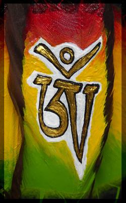 Beschilderde Veer - Rasta Om detail