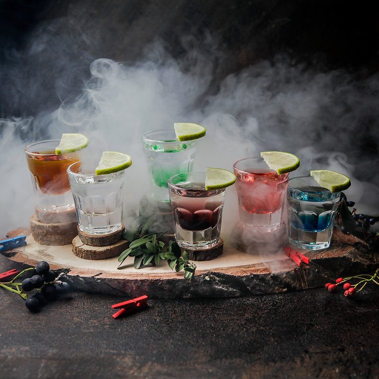 side-view-shot-glasses-with-color-drinks