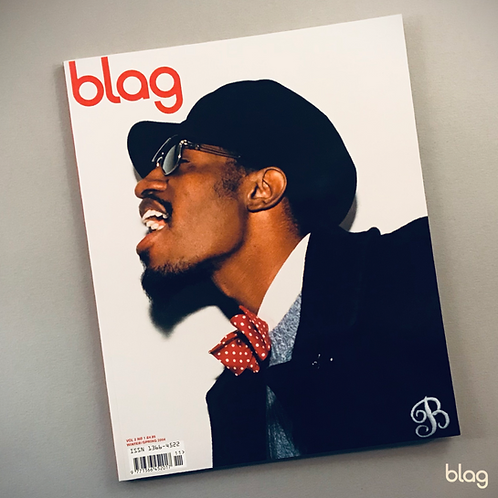 André 3000 cover BLAG magazine, portrait, singing, hat, sunglasses, bow tie. Photography Sarah J. Edwards