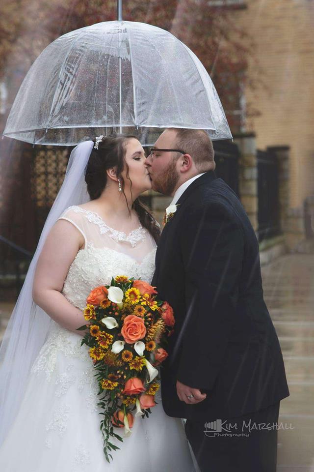 Rainy Wedding Day Kiss