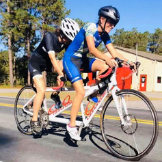 Alexandra and her pilot Shannon on the White Cannondale tandem bike at the White Lake Triathlon