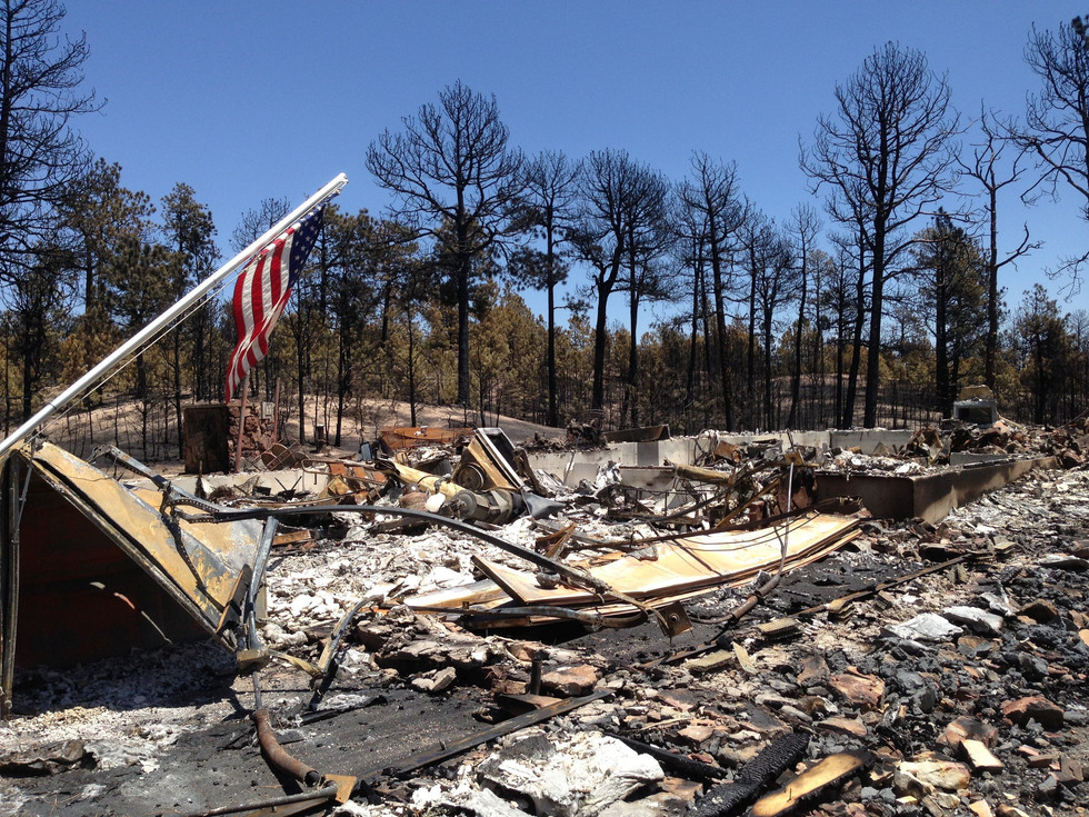 """The view when we approached the house. Two flags flew outside. One fell over, and the firefighters put it up """"Iwo Jima"""" style."""