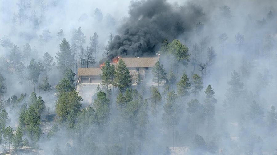 The first photo of the fire. It caught the pine tree on fire behind the garage.