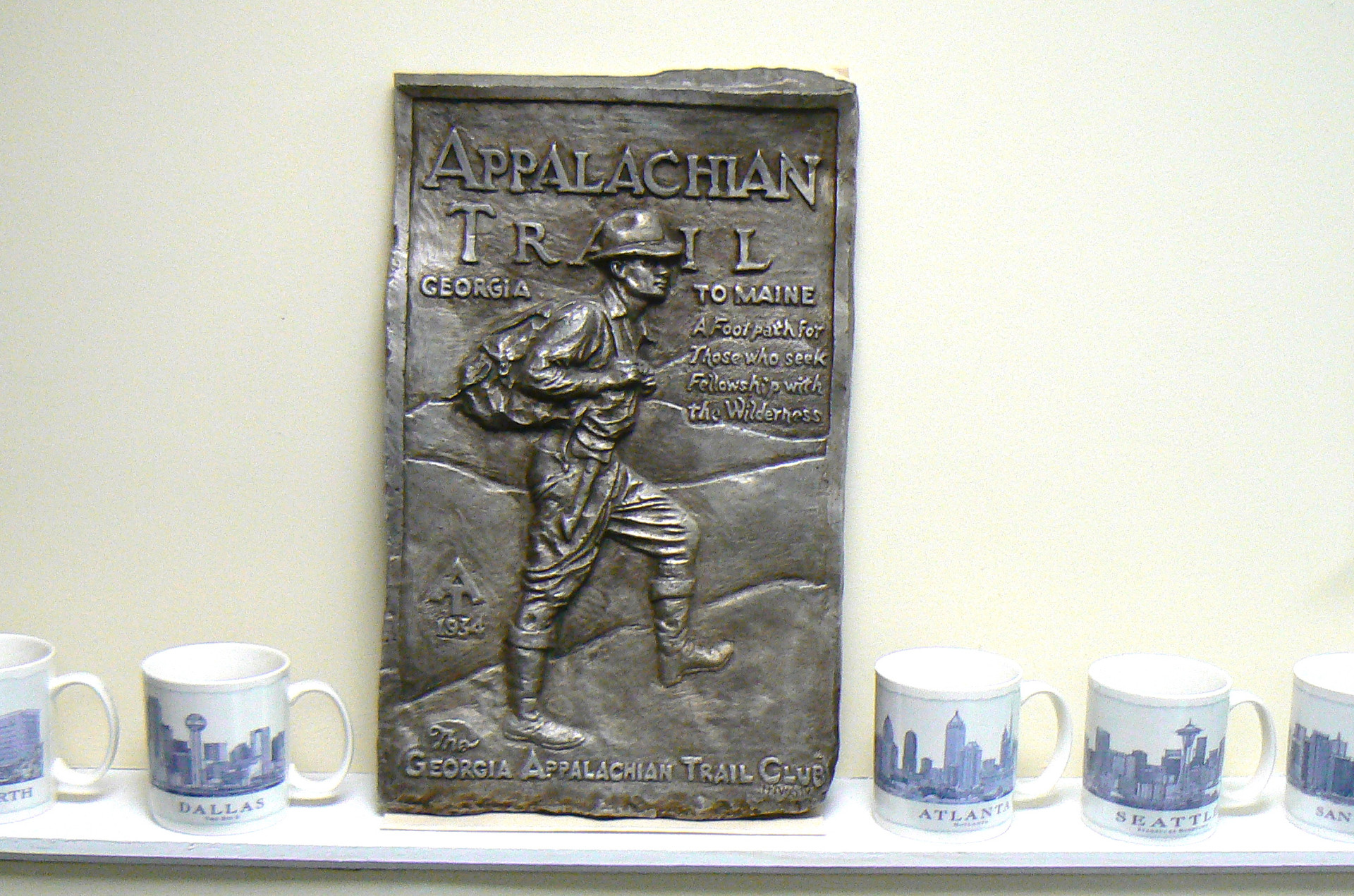 The AT plaque in better days. The large Starbucks mugs give a sense of perspective regarding its size.