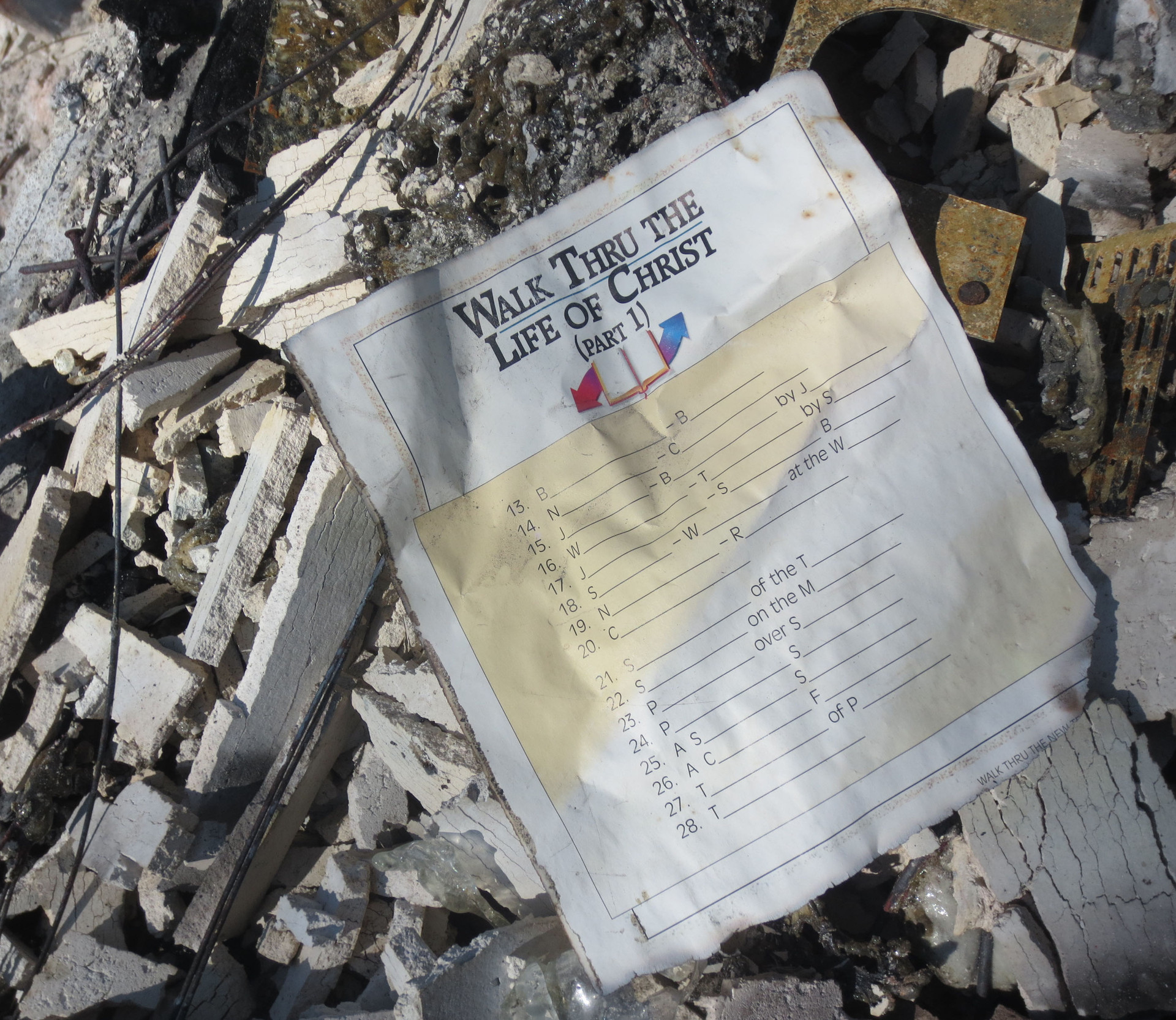 The first item we found, and the only book that survived: The Walk Thru the Bible notebook.