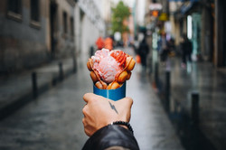 man-holds-bubble-waffle-from-street-food
