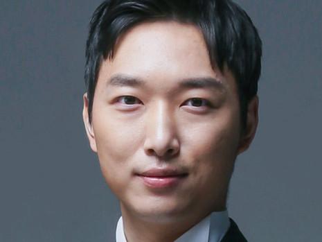 USIA Executive Director Y. H. Bryan Kim