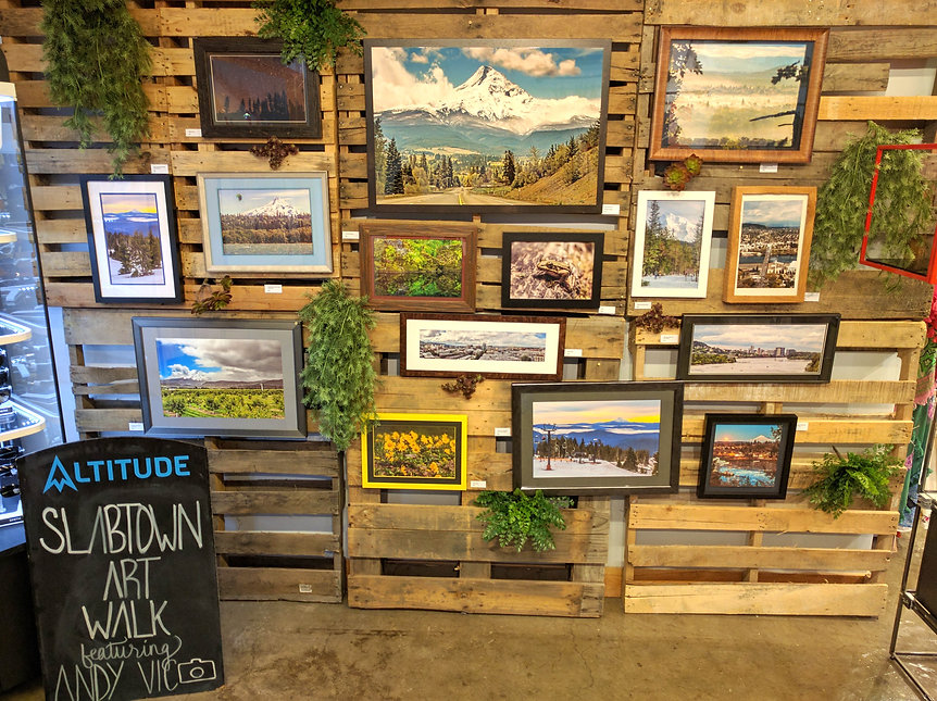 Random collection of framed prints displayed Altitude, Mt Hood Meadows retail store