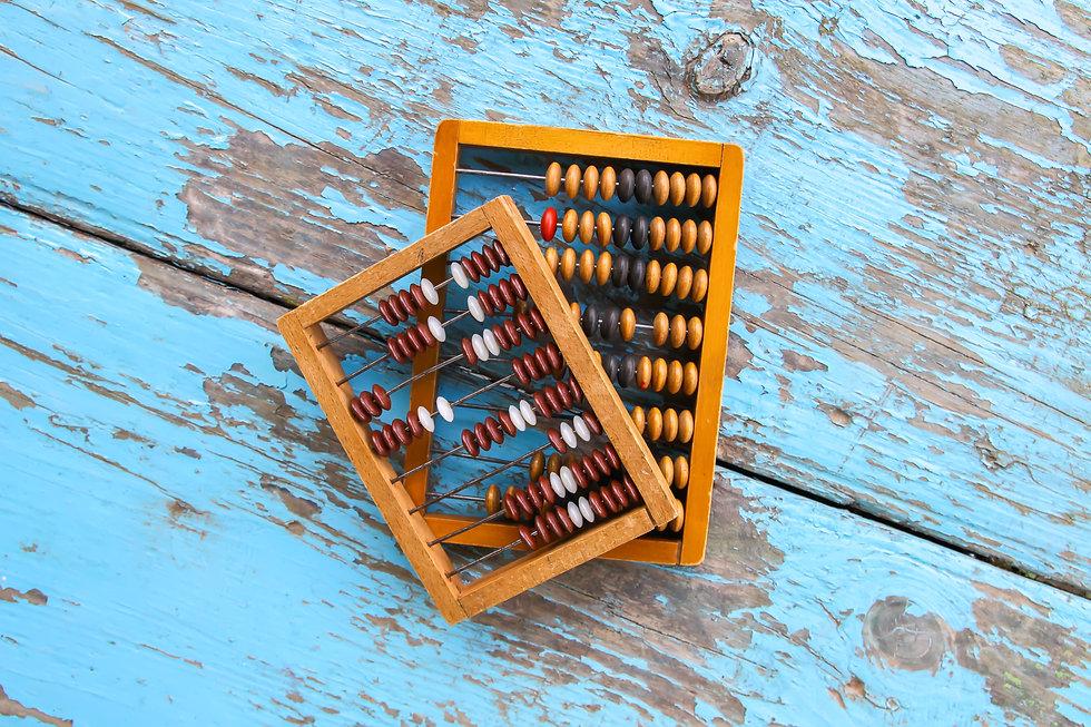 Vintage wooden abacus on oaged blue boar
