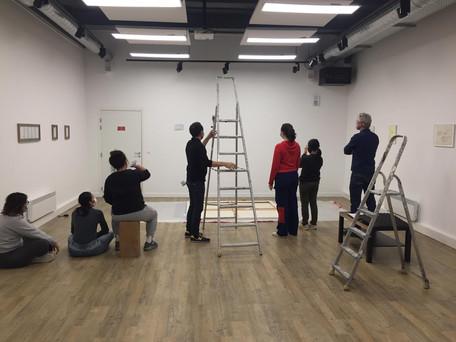 Working on hanging Larissa Fassler's painting