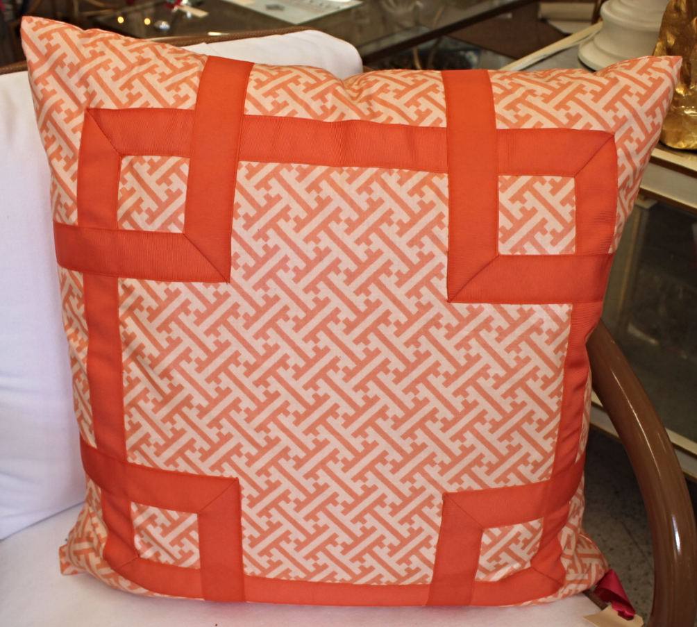 Orange and White Patterned Pillow