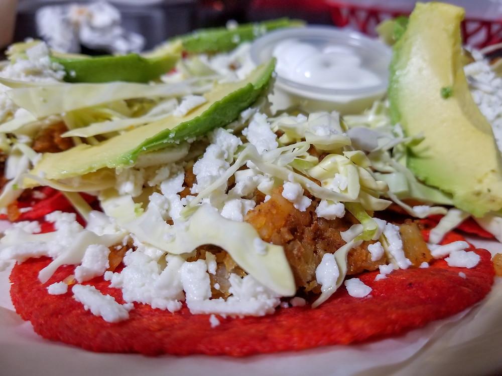Close up of tacos potosinos.