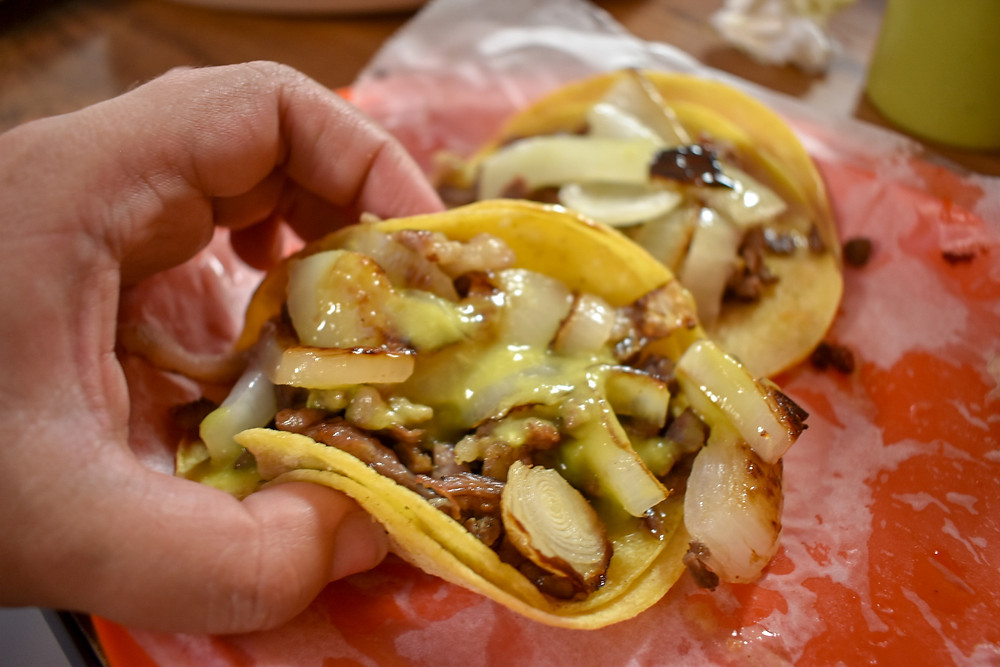 Tacos de carne asada topped with grilled onions at Taqueria Monterrey Chiquito in Houston, Texas