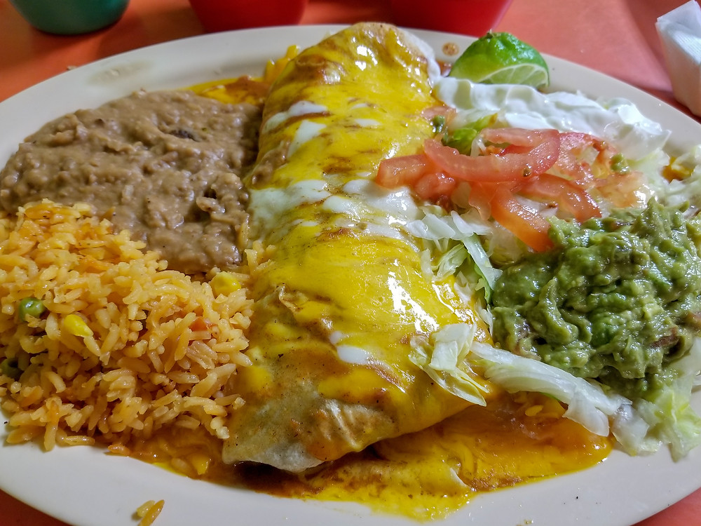 The Jalisco burrito spans the width of your plate.