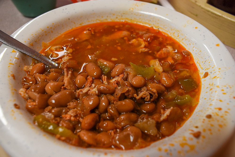 Frijoles Charros served with tacos at Taqueria Puro Jalisco in Pasadena, Texas