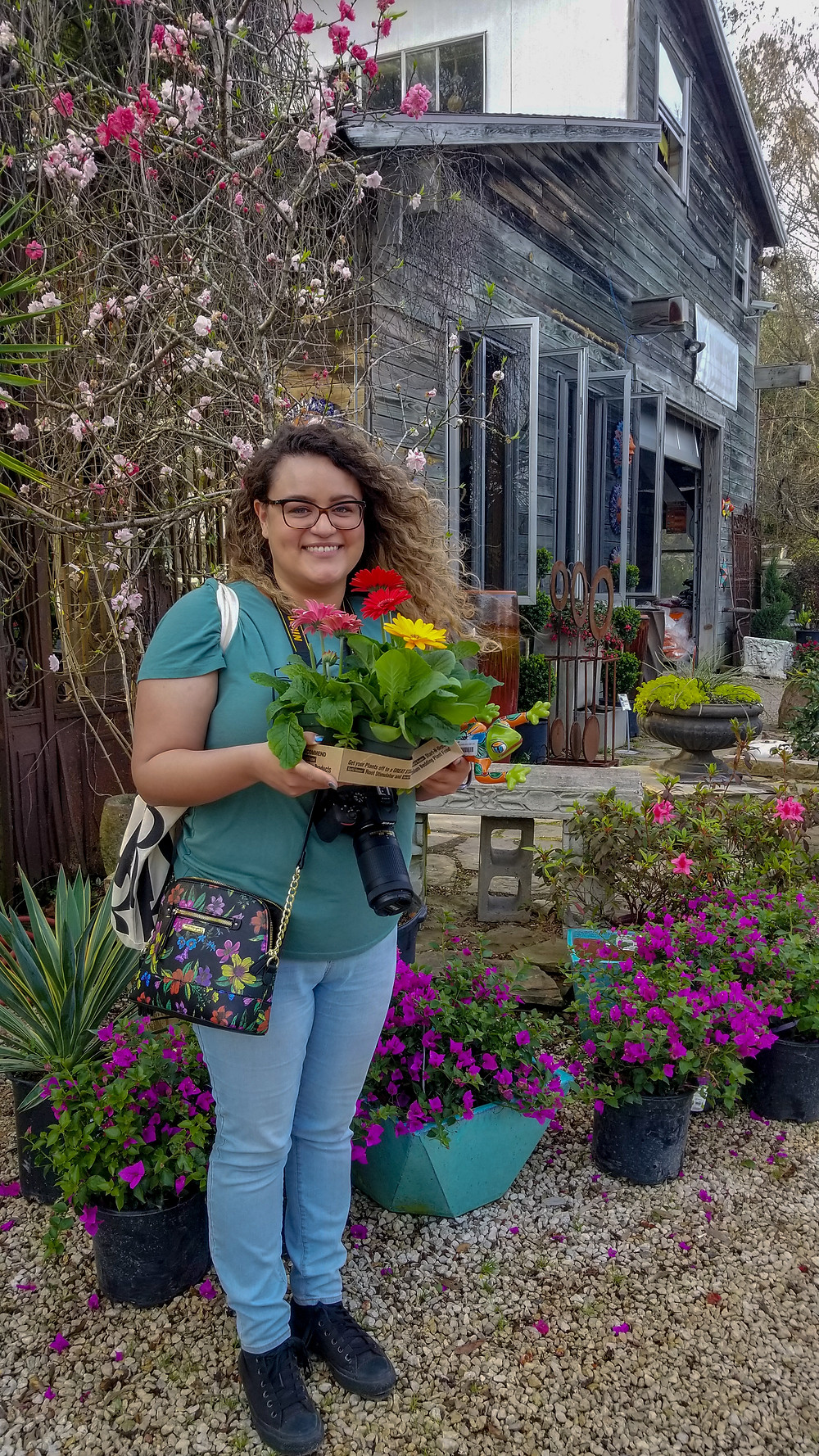 Paloma and the daisies at Maas Nursery in Seabrook, Texas