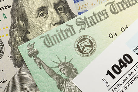 1040 Tax Form with Refund Check and Cash