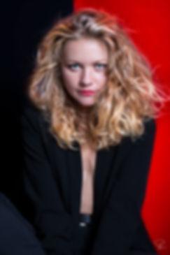 red,black,studio,lighting,portrait,blond,hair,eyes,blue