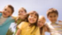 Portrait of happy children embracing eac