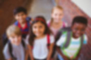 Portrait of smiling little school kids i
