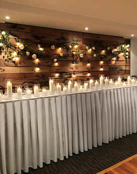 Bridal-table-with-festoons-and-flowers.jpg